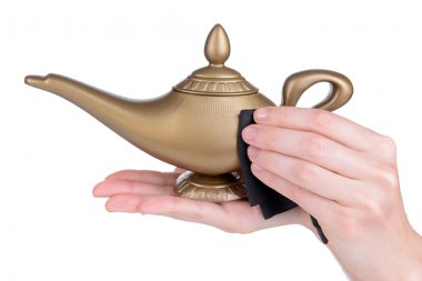 Magic lamp in female hands isolated on white