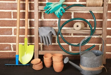 Tools of gardener on  bricks background