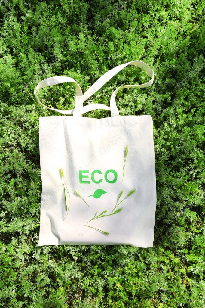 Eco bag on green grass