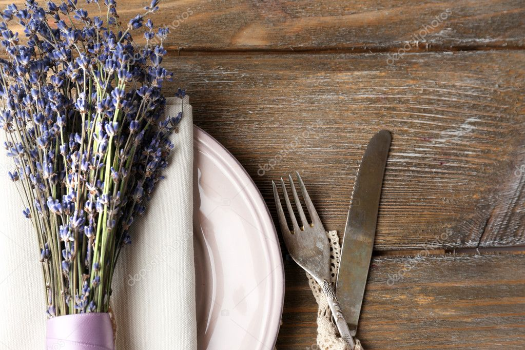 Dinner Table Background dining table setting with lavender flowers on wooden table