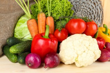 Fresh vegetables on wooden table close up