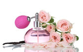 Fotografie Perfume bottle with roses isolated on white