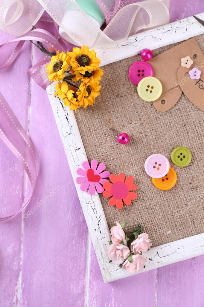 Scrapbooking Craft Materials And Wooden Frame With Sackcloth Inside