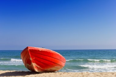 Red boat on beach near to sea stock vector