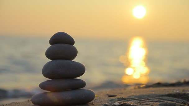 Stacked stones and sunset