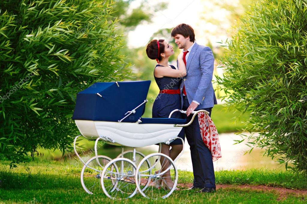 Family in the park with a stroller