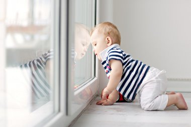 Little boy looking out the window