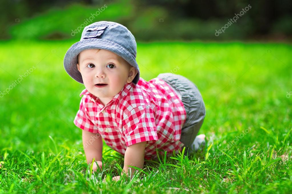 Cute baby crawling in the grass