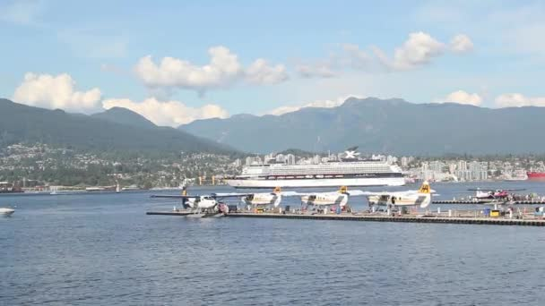 Seaplane Docks with Float Planes Moving Cruise Ship and Sea Bus along False Creek in Vancouver BC Canada with View of Mountain and North Vancouver Time Lapse 1920x1080