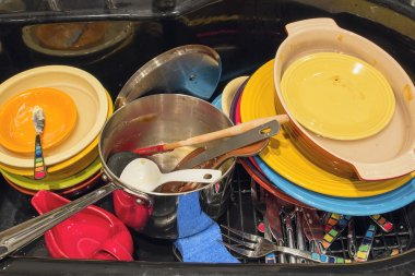 Kitchen Sink with Dirty Dishes Utensils and Pot