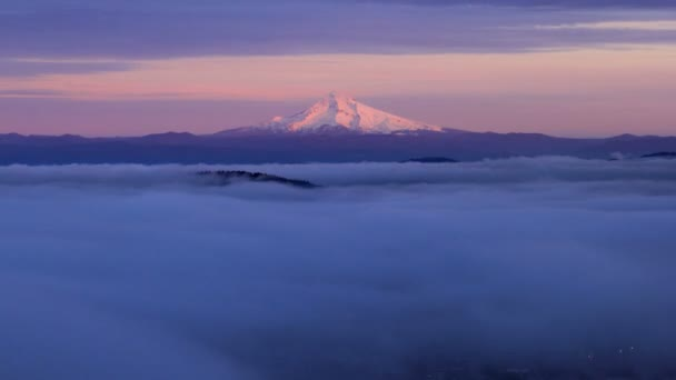 Portland Oregon City Covered with Thick and Heavy Rolling Fog with Alpenglow on Mount Hood at Sunset Time Lapse 1080p