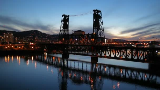 Portland Oregon Downtown Cityscape with Steel Bridge and Water Reflection Blue Hour Sunset at Night Panning HD Video 1080p