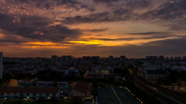 Time lapse zooming out movie of sunrise and auto traffic by Eunos MRT Station in Singapore. Eunos is a planned residential neighborhood east of the Central Area. 1080p