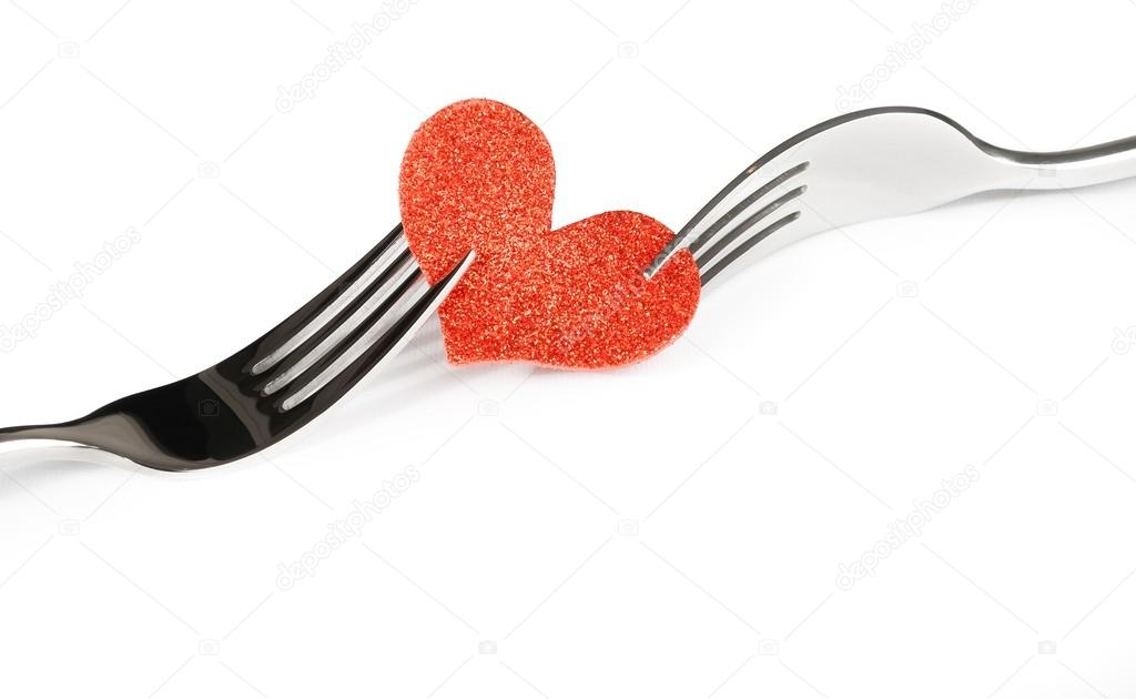 Detail Of Decorative Red Heart Near Forks On White Background
