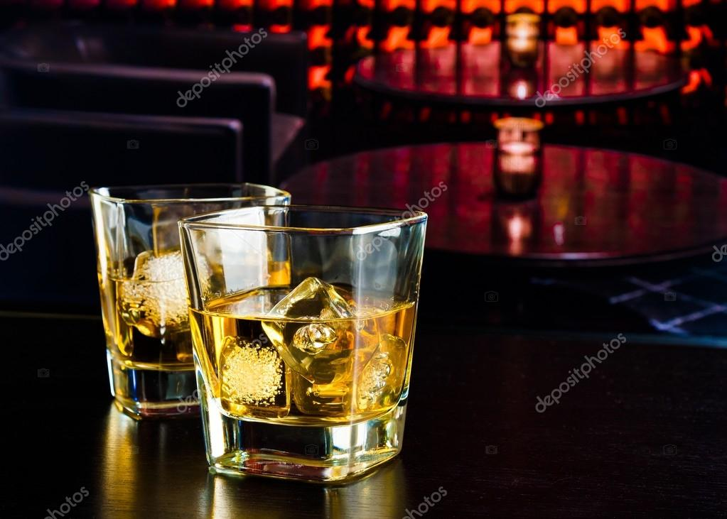 whiskey glasses with ice in a lounge bar