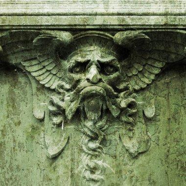 Devil on a gate