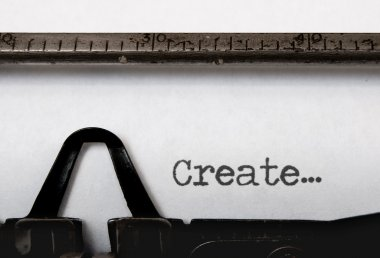 The word create written on a vintage typewriter stock vector