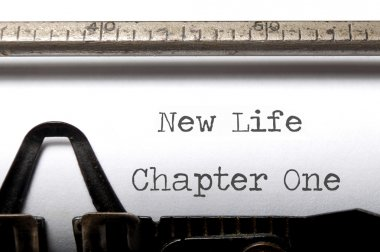 New life chapter printed on a vintage typewriter stock vector
