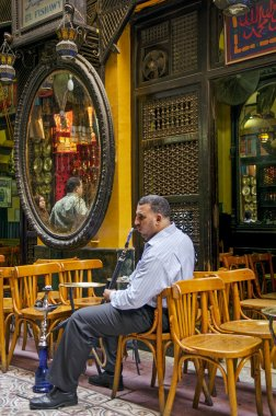 man smoking in cairo cafe in egypt