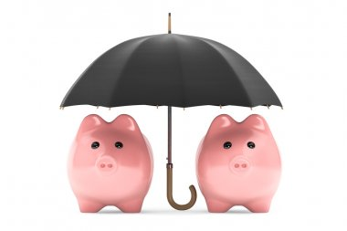 Wealth protection concept. Piggy Banks under umbrella