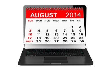 August calendar over laptop screen