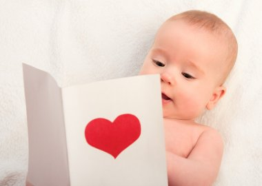 Beautiful baby and postcard Valentine