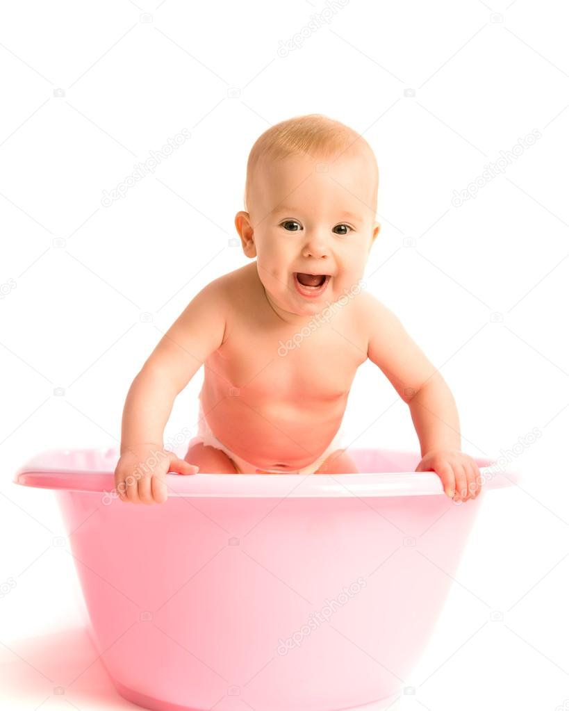 baby in a pink tub for bathing isolated — Stock Photo © evgenyataman ...