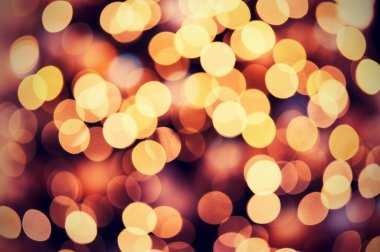 red golden Christmas lights background with bokeh