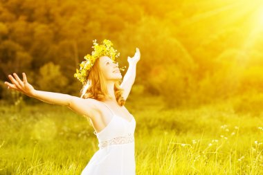 Happy woman in wreath outdoors summer enjoying life