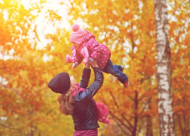 Нарру family. Mom and baby daughter for walk in autumn
