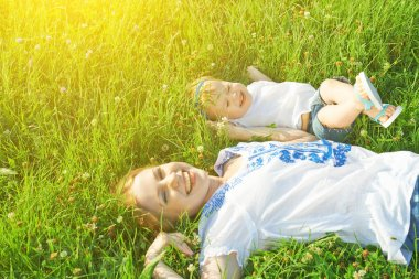 Happy family on nature. mom and baby daughter are playing in the