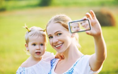 other , baby daughter photographing selfie themselves by mobile phone in summer