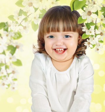 Cheerful little girl on an abstract background