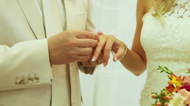 Groom Wears Wedding Ring on Womans Hand Bride Ceremony Stock Video