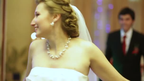 Newlyweds complete their wedding dance and kiss passionately