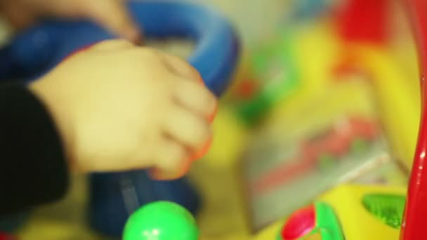 Baby plays with childrens toy cars
