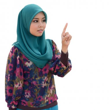 Young asian muslim woman in head scarf smile point finger