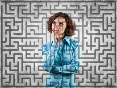 Girl before a labyrinth
