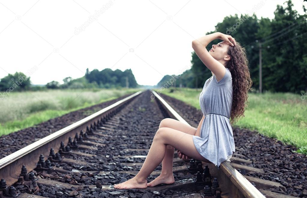 https://st.depositphotos.com/1192014/4983/i/950/depositphotos_49839293-stock-photo-girl-on-the-railway.jpg