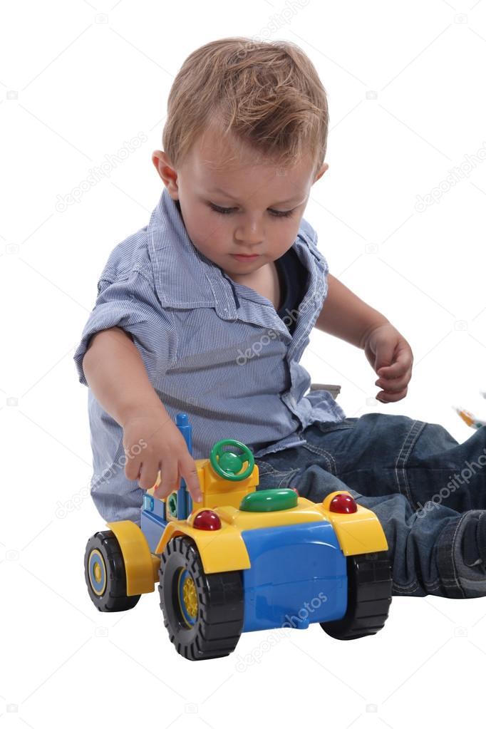 Nino Jugando Con Carro Nino Jugando Con Un Carro De Juguete Foto