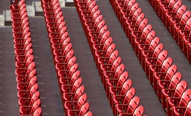 Rows of Red Sports Stadium seats stock vector