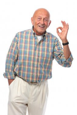 Senior man shows OK sign