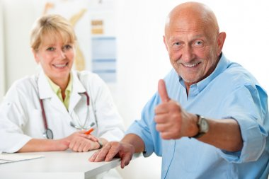 Happy senior patient and doctor