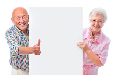 Happy smiling senior couple holding a blank board isolated on white stock vector
