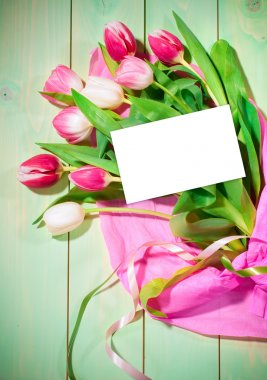 Bouquet of  tulips and card