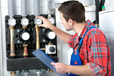 Technician servicing the gas boiler for hot water and heating stock vector