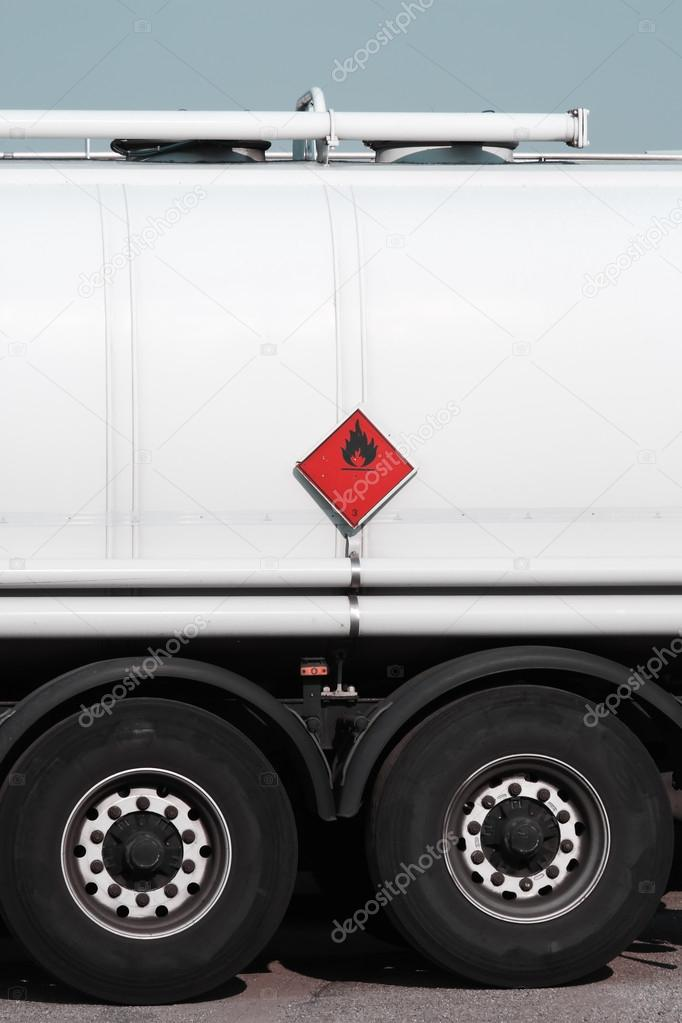 red sign on fuel tanker truck