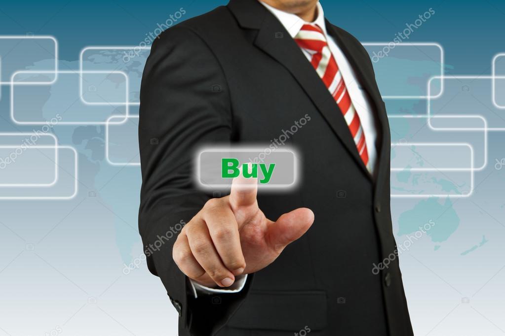 1579603537fa Бизнесмен нажать кнопку Купить — Стоковое фото © pinkblue  24724023