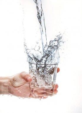 Holding cups, splashing water