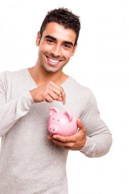 Man saving money to a piggy bank